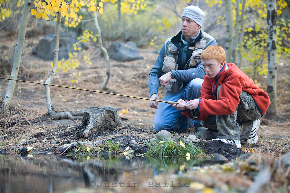 Father and his sons fly fishing near Reno, NV