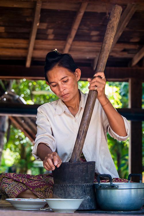 Mother preparing dinner under her house in Cambodia