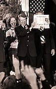 """Carter cousin Betty Pope reacts as President-elect Jimmy Carter holds a newspaper with the headline """"Carter Wins"""" as he celebrates with crowds filling the streets of tiny Plains, Georgia, on election night."""