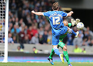 Craig Mackail-Smith foiled by Heurelho Gomes during the Sky Bet Championship match between Brighton and Hove Albion and Watford at the American Express Community Stadium, Brighton and Hove, England on 25 April 2015.