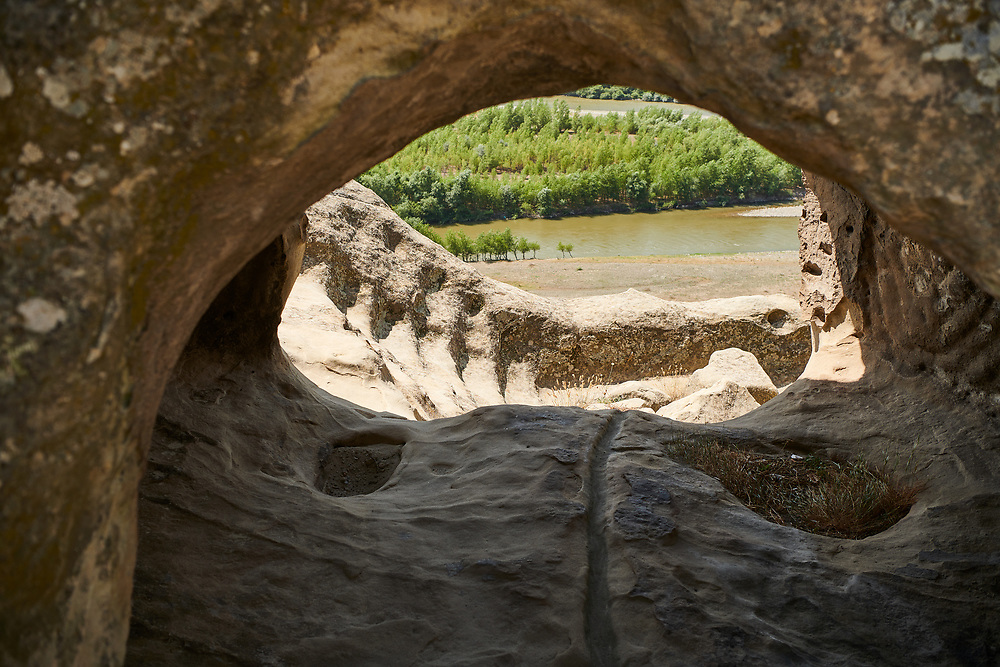 Picture & image of cave dwellings, Uplistsikhe (Lords Fortress) troglodyte cave city, near Gori, Shida Kartli, Georgia. UNESCO World Heritage Tentative List<br /> <br /> Inhabited from the early Iron age to the late middle ages Uplistsikhe cave city eas, during the Roman & Hellenistic period, home to around 20,000 people.