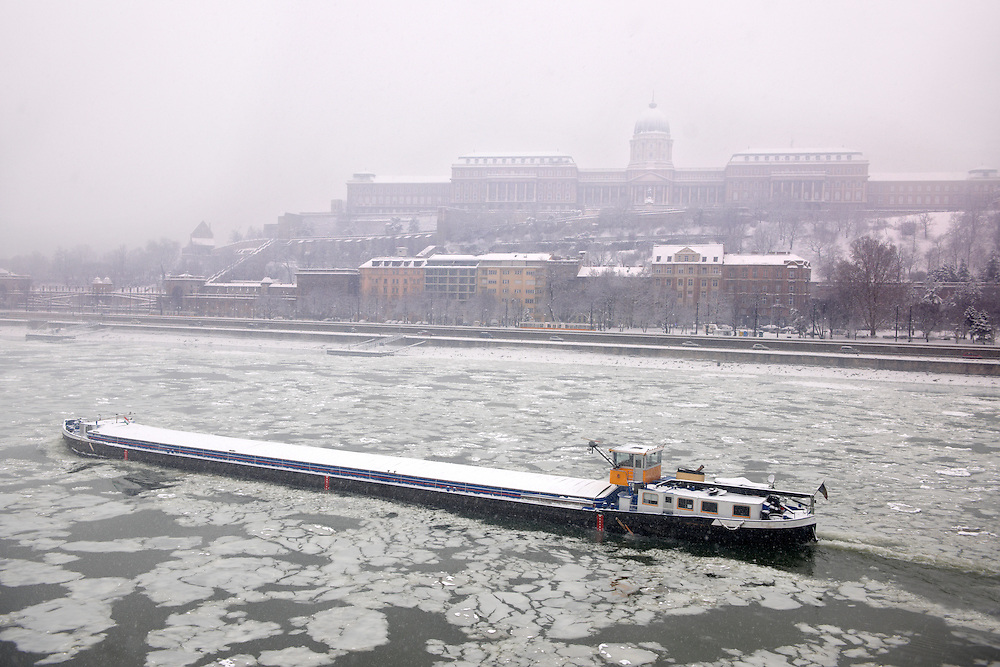 Ice on the frozen Danube and winter snow. Budapest winter photos .<br /> <br /> Visit our HUNGARY HISTORIC PLACES PHOTO COLLECTIONS for more photos to download or buy as wall art prints https://funkystock.photoshelter.com/gallery-collection/Pictures-Images-of-Hungary-Photos-of-Hungarian-Historic-Landmark-Sites/C0000Te8AnPgxjRg