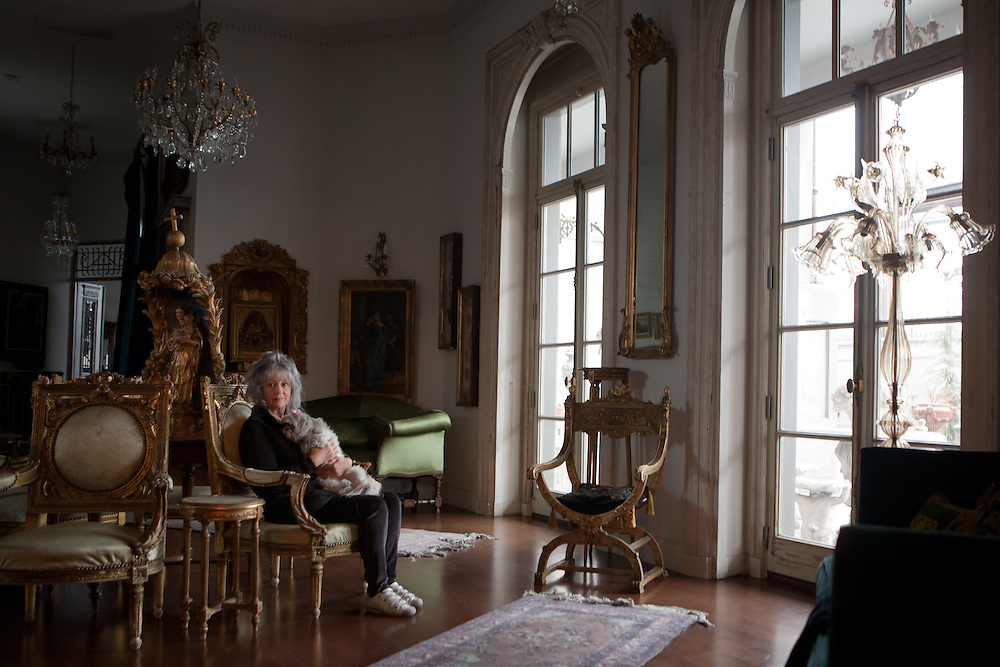 Gertrude Zachary, holding her dog, spent her life collecting antiques and designing jewelry. Now she's living in her dream home in downtown Albuquerque...CREDIT: Steven St. John for The Wall Street Journal