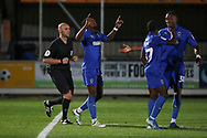 AFC Wimbledon attacker Michael Folivi (17) celebrating after scoring goal to make it 2-0 during the Leasing.com EFL Trophy match between AFC Wimbledon and Leyton Orient at the Cherry Red Records Stadium, Kingston, England on 8 October 2019.