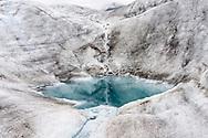 Small melt water pool on the Grosser Aletschgletscher, the biggest glacier in the Alps, Riederalp, Valais, Switzerland