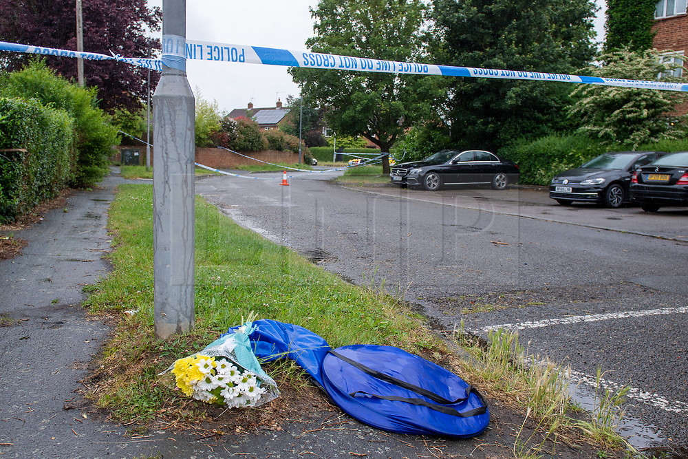 © Licensed to London News Pictures. 21/06/2021. Burnham, UK. Flowers at the scene following the death of a man in Wyndham Crescent in Burnham on Monday 20/06/2021. Emergency services were called at approximately 13:10BST to the Buckinghamshire street following reports of an altercation involving a group of men. Shortly after this a 35-year-old man collapsed. Thames Valley Police officers and paramedics attended the scene and performed CPR on the man but he was later pronounced dead. Photo credit: Peter Manning/LNP