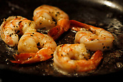 Close up photo of shrimp scampi cooking in a skillet