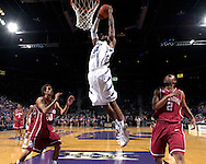 Kansas State guard Akeem Wright (C) drives in for the dunk between Oklahoma defenders Michael Neal (2) and Austin Johnson (20) in the final minute of the Wildcats 72-61 win at Bramlage Coliseum in Manhattan, Kansas, March 3, 2007.