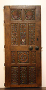 Wood-carved door from a mansion on Rhodes.  18th century wood-carved decoration with coloured floral motifs.