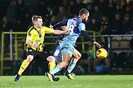 Burton Albion midfielder Jamie Allen (4) and Wycombe Wanderers Curtis Thompson (18) during the EFL Sky Bet League 1 match between Burton Albion and Wycombe Wanderers at the Pirelli Stadium, Burton upon Trent, England on 26 December 2018.