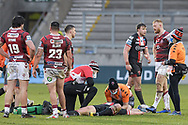 James Greenwood (21) of Salford Red Devils receives treatment on the pitch after an injury