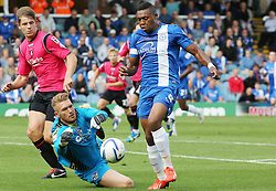 Peterborough United's Britt Assombalonga gets brought down by Oldham Athletic's Mark Oxley for a penalty  - Photo mandatory by-line: Joe Dent/JMP - Tel: Mobile: 07966 386802 17/08/2013 - SPORT - FOOTBALL - London Road Stadium - Peterborough -  Peterborough United V Oldham Athletic - Sky Bet League One