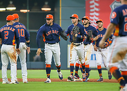 April 29, 2018 - Houston, TX, U.S. - HOUSTON, TX - APRIL 29:  Houston Astros right fielder George Springer (4) high fives with teammates after defeating the Oakland Athletics 8-4 during the baseball game between the Oakland Athletics and Houston Astros on April 29, 2018 at Minute Maid Park in Houston, Texas.  (Photo by Leslie Plaza Johnson/Icon Sportswire) (Credit Image: © Leslie Plaza Johnson/Icon SMI via ZUMA Press)