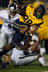 California running back Damien Moore (28) breaks a big gainer against Nevada during the first quarter of an NCAA college football game, Saturday, Sept. 4, 2021, in Berkeley, Calif. (AP Photo/D. Ross Cameron)
