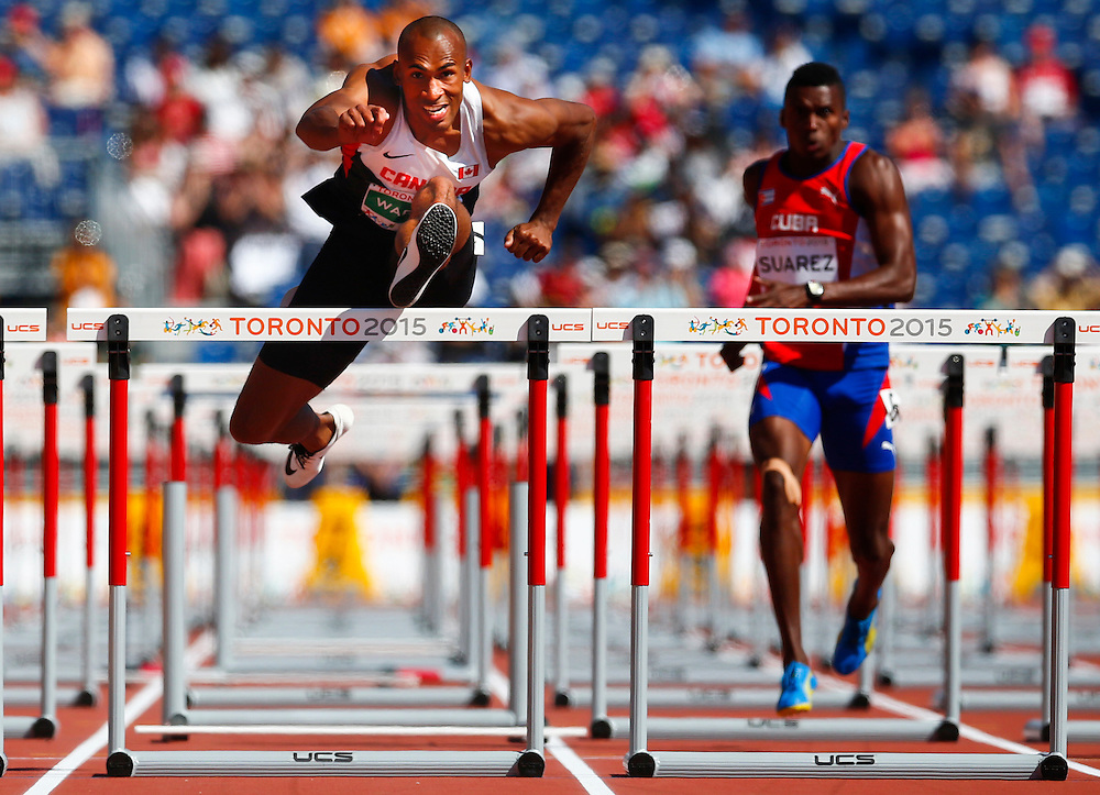 Damian Warner of Canada in the 110m hurdles in the men's decathlon during the athletics at the Pan Am Games in Toronto, Thursday July 23, 2015.    THE CANADIAN PRESS/Mark Blinch