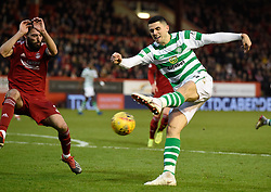Celtic's Tom Rogic has a shot at goal as Aberdeen's Graeme Shinnie attempts to block during the Scottish Premiership match at Pittodrie Stadium, Aberdeen.