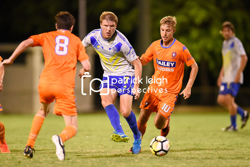 BRISBANE, AUSTRALIA - JANUARY 27: Michael Lee of the Strikers passes the ball under pressure from Mitch Hore and Jesse Daley of Lions during the Kappa Silver Boot Grand Final match between Lions FC and Brisbane Strikers on January 27, 2018 in Brisbane, Australia. (Photo by Patrick Kearney)