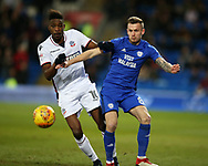 Sammy Ameobi of Bolton Wanderers challenges Joe Ralls of Cardiff city (r) . EFL Skybet championship match, Cardiff city v Bolton Wanderers at the Cardiff city Stadium in Cardiff, South Wales on Tuesday 13th February 2018.<br /> pic by Andrew Orchard, Andrew Orchard sports photography.