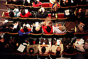 overhead view of people in a theater
