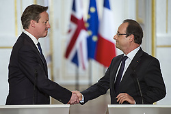 59680175  .French President Francois Hollande (R) and visiting British Prime Minister David Cameron attend a joint press conference at the Elysee Palace in Paris, France, May 22, 2013. French President Francois Hollande and British Prime Minister David Cameron on Wednesday condemned the assassination of a British soldier in the suburbs of London after their meeting in Paris, France, May 22, 2013. Photo by: imago / i-Images. UK ONLY