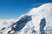 Emmons Glacier on Mount Rainier, Washington, has the largest surface area of any glaicer in the contiguous United States. It has a surface area of 4.3 square miles (11 km²). In this aerial view, Emmons Glacier stretches past Gibraltar Rock (at left) and Disappointment Cleaver (at lower right).