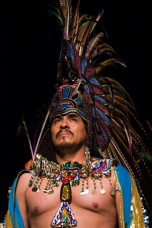 A male performer wears an elaborate costume as an Aztec king during the performance of Bani Stui Gulal in Dance Square, next to the Basilica de la Soledad, in Oaxaca City, Oaxaca state, Mexico on July 19, 2008. The show tells the story of the Guelaguetza as it evolved through the ages, from pre-Hispanic origins to modern times.
