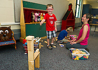 Hayden Cardinal and Ethan Spulick play in the new Preschool room with Kiersten Foster at Pleasant Street Elementary School on Thursday morning.  (Karen Bobotas/for the Laconia Daily Sun)