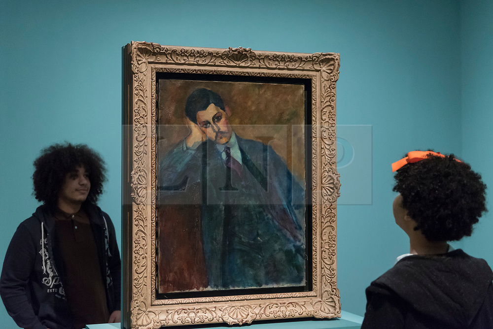 """© Licensed to London News Pictures. 21/11/2017. London, UK.  Staff members view """"Jean Alexandre (recto)"""", 1909. Preview of """"Modigliani"""", the most comprehensive exhibition of works by Amedeo Modigliani ever held in the UK.  On display are iconic portraits, sculptures and 12 nudes, the largest group ever shown in the UK.  The show runs 23 November to 2 April 2018.  Photo credit: Stephen Chung/LNP"""