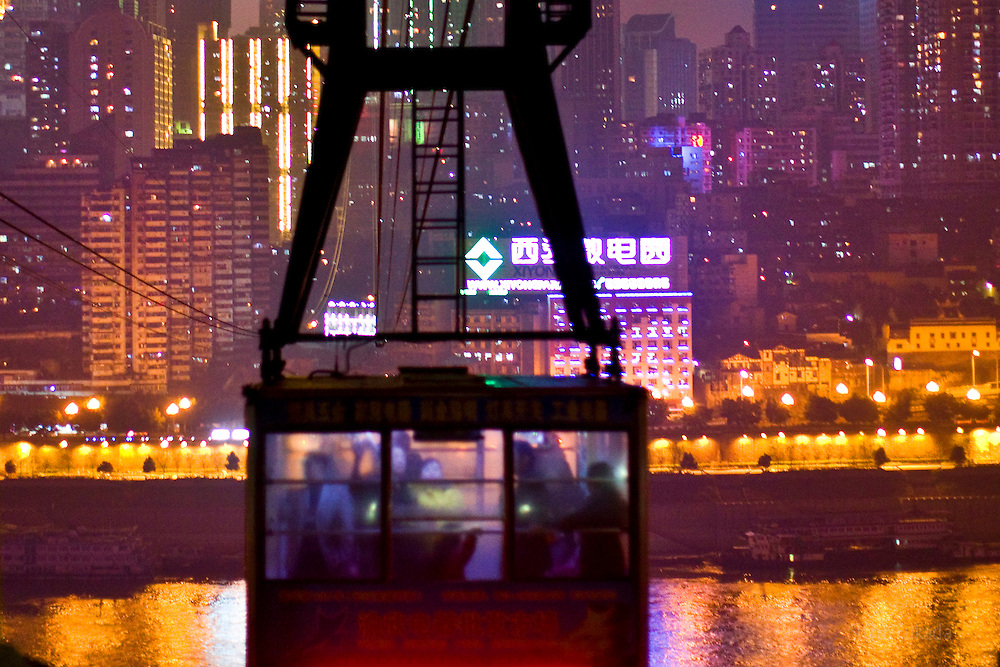 People take cable car in Chongqing, China, March 3, 2009.