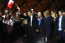 Emmanuel Macron is surrounded on stage by wife Brigitte and family members after winning the French presidential election, at the Louvre Pyramid in Paris, France on May 7, 2017. Macron, a 39-year-old pro-business centrist, defeated Marine Le Pen, a far-right nationalist who called for France to exit the European Union, by a margin of 65.5 % to 34.1%, becoming the youngest president in France's history. Photo by ABACAPRESS.COM