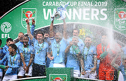 Manchester City players celebrate after winning the Carabao Cup Final at Wembley Stadium, London.