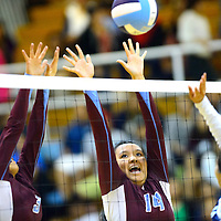091013  Adron Gardner/Independent<br /> <br /> Ganado Hornets Mariah Cook (3), left, and Rianna Kee (14) attempt a block on Window Rock Scout Jamie Parish (10) in Fort Defiance Tuesday.