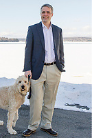 Steve Tucker and Finnegan take a morning walk.  (Karen Bobotas/for the Laconia Daily Sun)