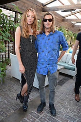 CLARA PAGET and OSCAR TUTTIETT attending the Warner Bros. & Esquire Summer Party held at Shoreditch House, Ebor Street, London E1 on 18th July 2013.