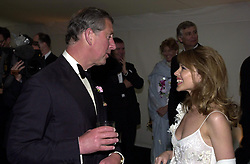 Embargoed to 0001 Monday May 28 File photo dated 11/6/2001 of the Prince of Wales and Kylie Minogue during the 'Its Fashion' charity gala dinner at Waddesdon Manor, Buckinghamshire. The pop star and actress turns 50 on Monday.