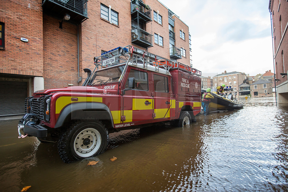 © Licensed to London News Pictures. 16/11/2015. York UK. The Fire & Rescue service launch a boat on to the River Ouse after the river broke it's banks in York & flooded buildings & roads through the centre of the city after this weekends heavy rain. Photo credit: Andrew McCaren/LNP