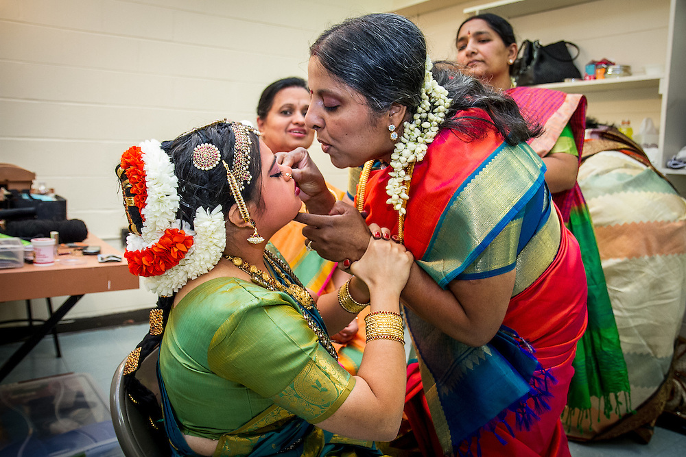 Lincroft, New Jersey, 9/20/14: Chitra Venkateswaran (right) inserts Hema Ramaswamy's nose ring. Hema, a young Indian American woman with Down syndrome, is preparing backstage for her arangetram, the public performance of bharata natyam, a traditional South Indian dance form. She studied with Chitra in preparation for this recital for four and a half years.