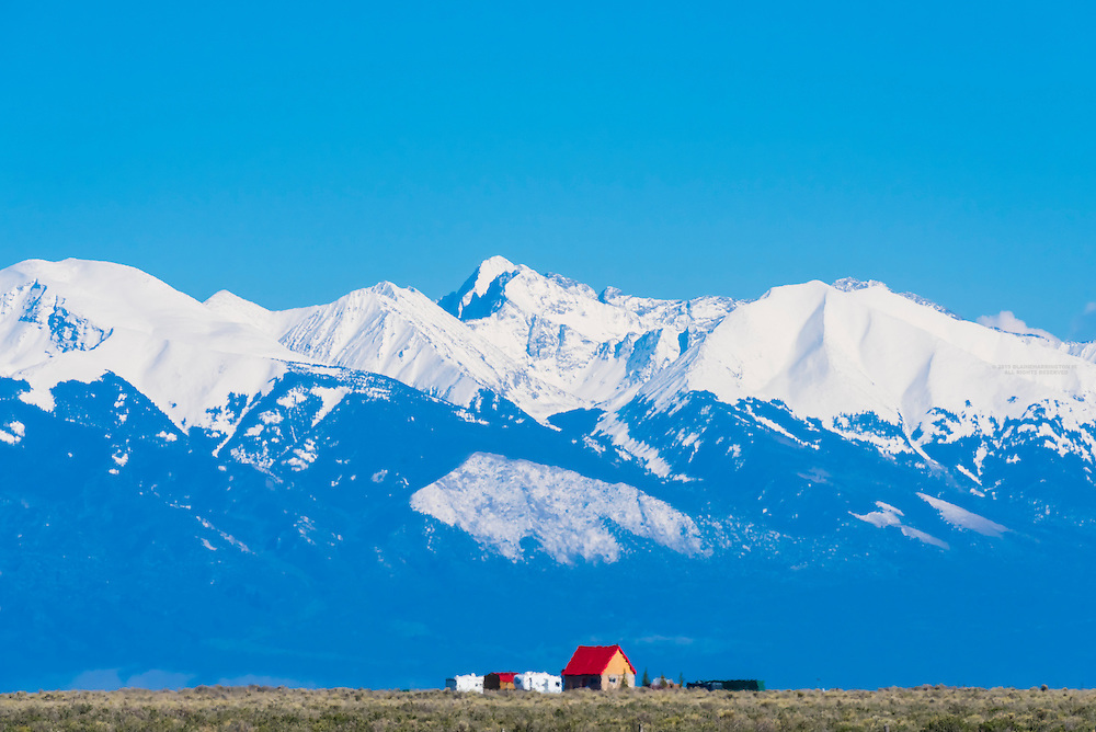 Snow capped peaks of the Sangre de Cristo range of the Rocky Mountains ring the San Luis Valley in Southern Colorado, USA.