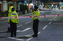 © Licensed to London News Pictures. 05/02/2020. London, UK. Officers maintain a cordon after the Metropolitan Police Service was called to Kingsley Rd in Hounslow at 19:23GMT on Tuesday 4th Feb to reports of a fight. A 19-year-old man then self-presented at a hospital with stab injuries. One person has been arrested. Photo credit: Peter Manning/LNP