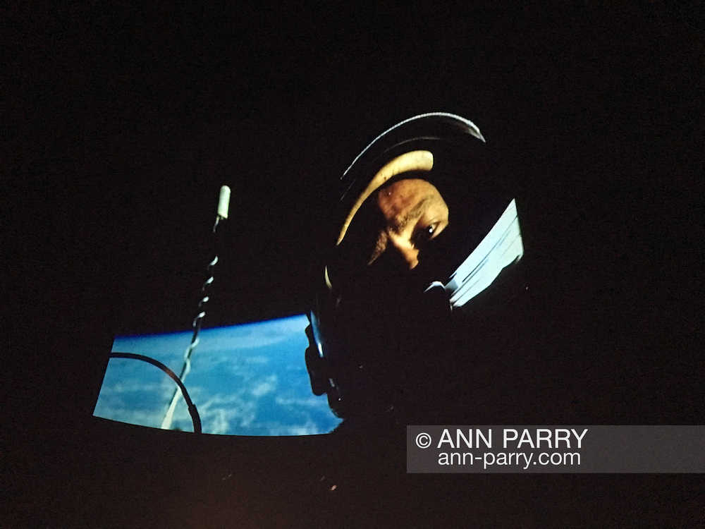 Garden City, New York, USA. October 23, 2015. This first Selfie taken in Space, with Earth in background, was taken during 1966 Gemini 12 flight by Buzz Aldrin during the first successful space walk, explains former NASA astronaut Edwin BUZZ ALDRIN during his conversation with his Mission Director, Christina Korp. Aldrin discussed his early life, his experiences in space and his new Children's  Middle Grade book Welcome to Mars: Making a Home on the Red Planet. Photo was projected on dome of the jetBlue Sky Theater Planetarium at Long Island's Cradle of Aviation Museum. On the 1969 Apollo 11 mission, Buzz Aldrin was the second person ever to walk on the Moon.