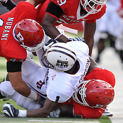 Oct 10, 2009; Piscataway, NJ, USA; Texas Southern wide receiver Joe Anderson (1) is gang tackled by Rutgers defenders during first half NCAA college football action between Rutgers and Texas Southern at Rutgers Stadium.