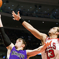 21 December 2009: Sacramento Kings forward Andres Nocioni goes up for a layup against Chicago Bulls center Joakim Noah during the Sacramento Kings 102-98 victory over the Chicago Bulls at the United Center, in Chicago, Illinois, USA.