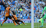 Brighton winger, Jamie Murphy whips in a cross the Sky Bet Championship match between Brighton and Hove Albion and Hull City at the American Express Community Stadium, Brighton and Hove, England on 12 September 2015.