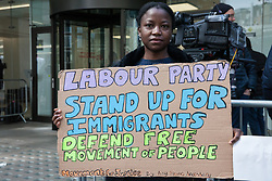 London, UK. 30th April 2019. An activist from Movement for Justice calling for freedom of movement protests outside Labour Party HQ as Labour Party NEC members arrive for a meeting to confirm plans for Labour's EU election manifesto, including its stance with regard to a second referendum.
