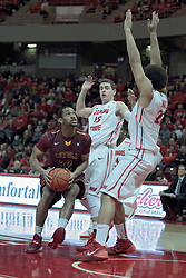 11 January 2014:  Christian Thomas meets defenders Nick Zeisloft & Reggie Lynch during an NCAA  mens basketball game between the Ramblers of Loyola University and the Illinois State Redbirds  in Redbird Arena, Normal IL.  Redbirds win 59-50