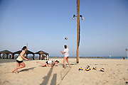 Israel, Tel Aviv playing volleyball on the beach