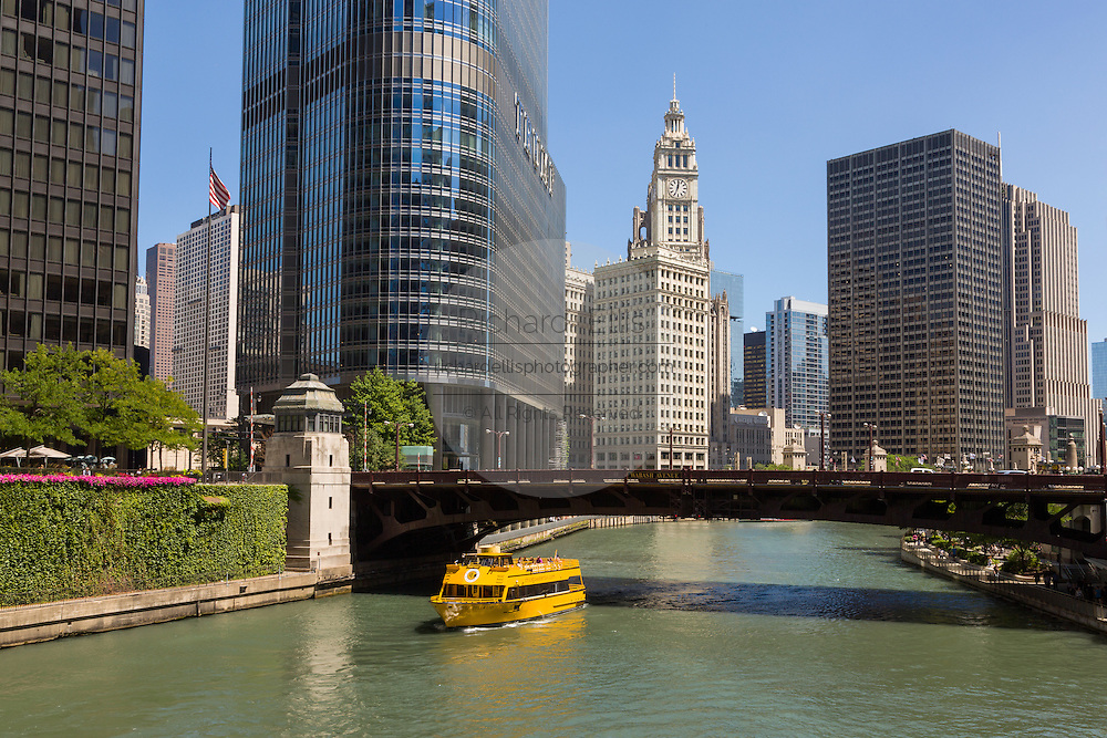 The water taxi boat along the Chicago River looking toward the Wabash Bridge, Wrigley Building and skyline during summer in Chicago, Illinois, USA