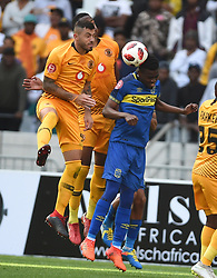 Cape Town-180915-  Cape Town City  midfielder Mpho Matsi wins an aerial ball when challenged  by Kaizer Chiefs Daniel Cardoso  in the ABSA Premiership clash at the Cape Town Stadium.City are trying to keep winning their home games and their position on the log.Photographs:Phando Jikelo/African News Agency/ANA