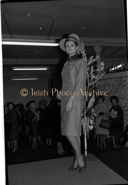 09/03/1964<br /> 03/09/1964<br /> 09 March 1964<br /> McBirney's Fashion show at McBirney's, Aston Quay, Dublin. Image shows model Carol wearing a green two piece suit.