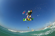 Mark Howes hitting a handle pass at Kite Beach, Dubai, United Arab Emirates.